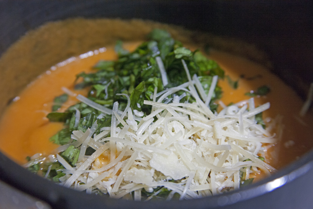 Basil and Parmesan in sauce.jpg