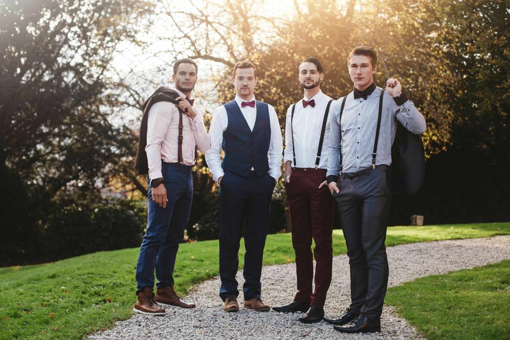groomsmen in braces and bow ties