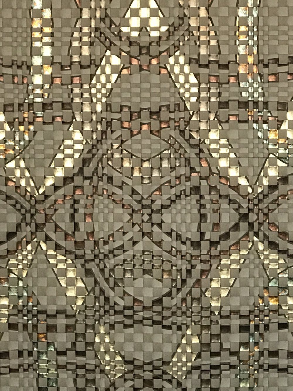 Gustav, gilded and hand woven leather wall.