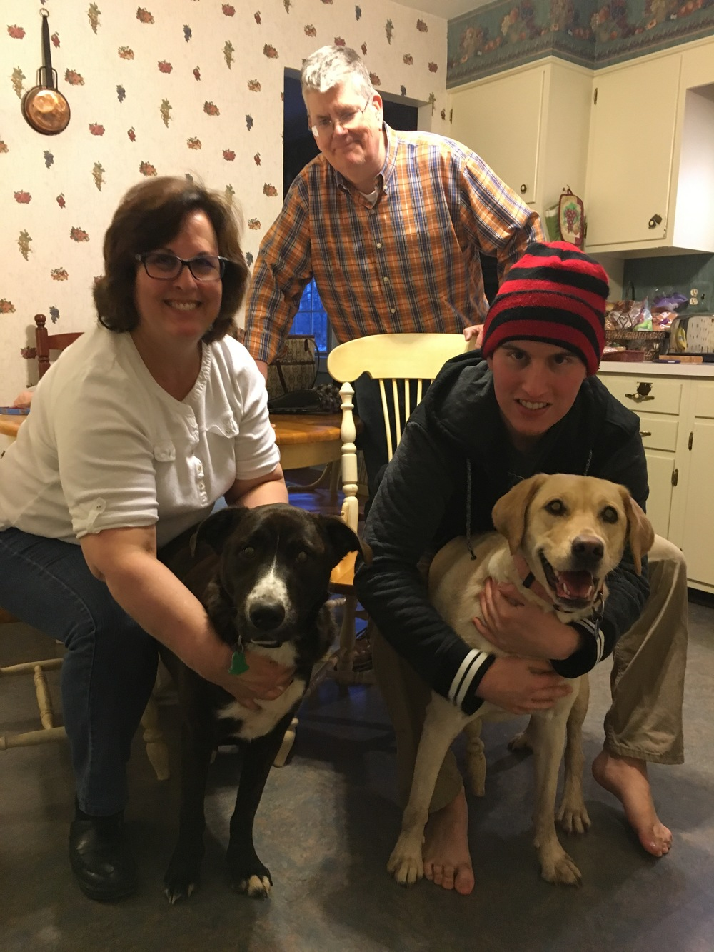 Bruno with his family and new fur sister, Lucy, on the right.