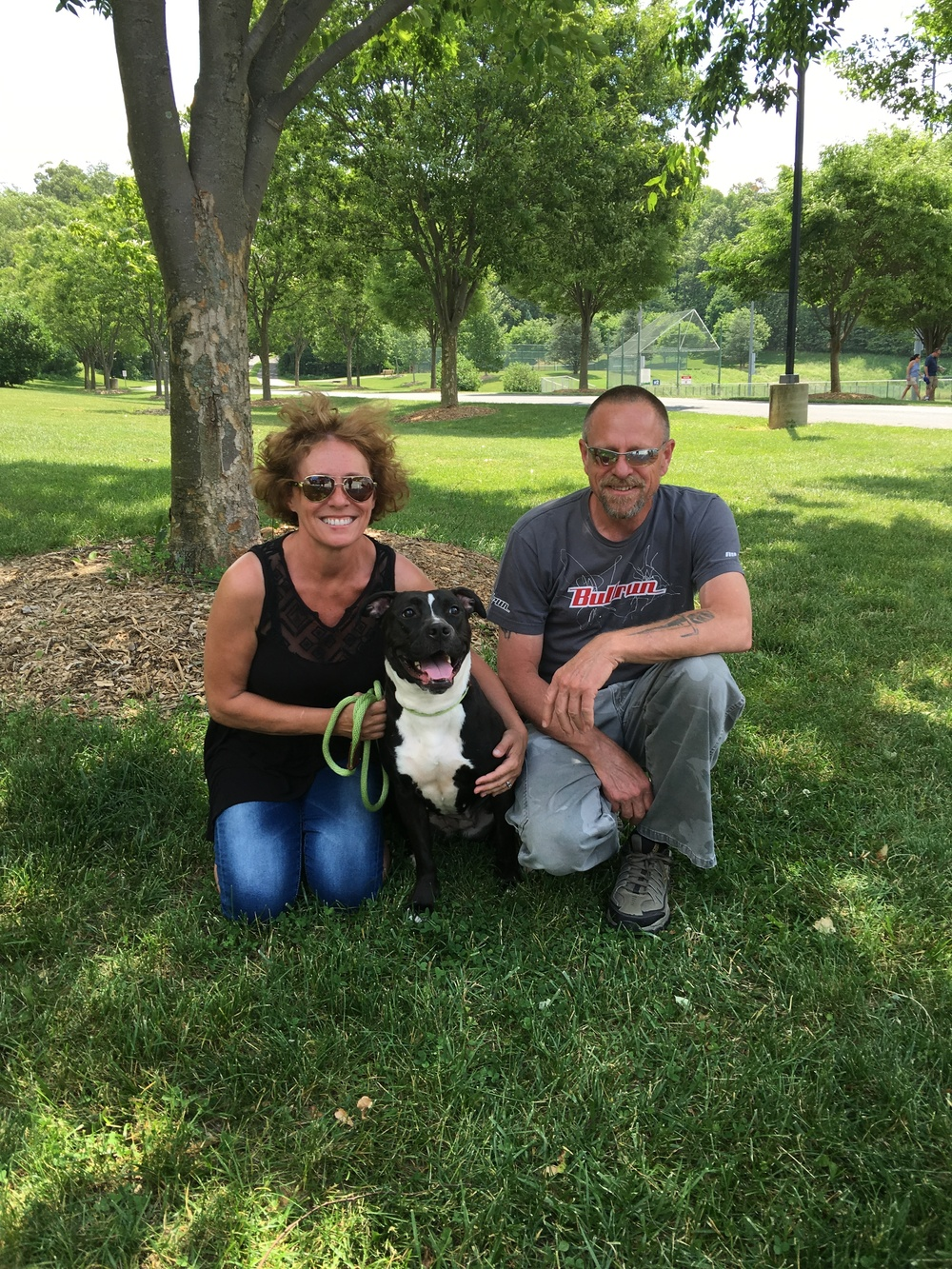 Lola has a huge smile after being adopted by Joyce and Sean!