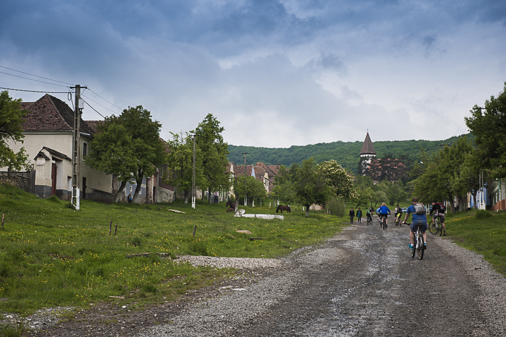 Cyclists pedal up Mesendorf High Street on their way for a picnic overlooking the village.JPG