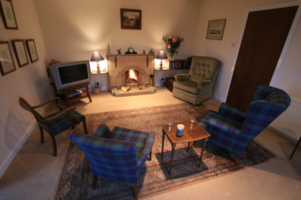 Woodlands Cottage Sitting Room, holiday lets perthshire, holiday homes dunkeld, glasgow, aberdeen, tay fishing, corporate reward weekends, corporate breaks, scottish salmon fishing, river tay, .jpg