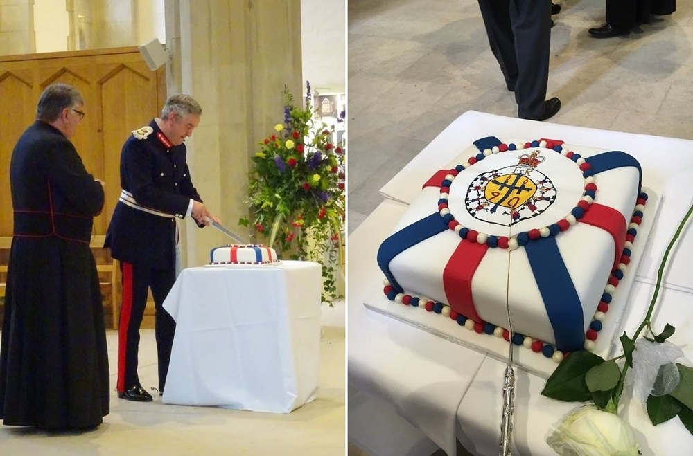 The Lord Lieutenant for South Yorkshire cutting the cake in celebration of the Queen's 90th Birthday.