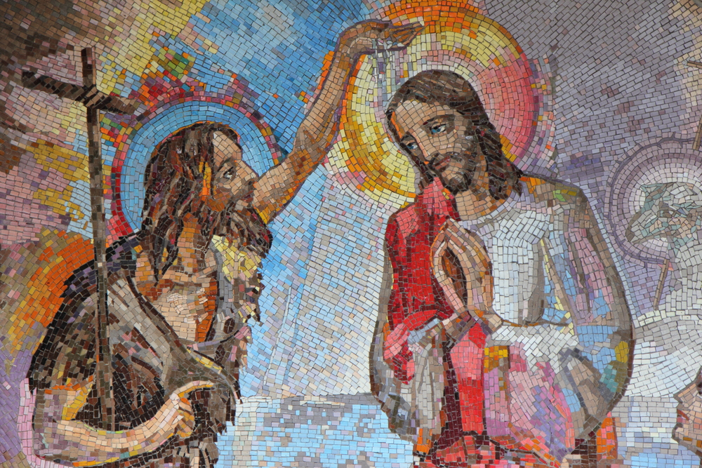 Mosaic of the baptism of Jesus Christ by Saint John the Baptist as the first Luminous mystery. Image used under license from Shutterstock.com