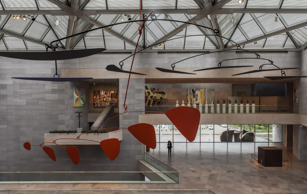 The Alexander Calder mobile moves gently on its axis in the East Building's main atrium. (Bill O'Leary/The Washington Post)