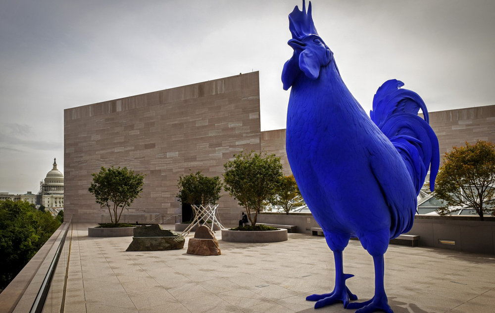 "Katharina Fritsch's ""Hahn/Cock,"" a 15-foot electric blue rooster, looks out over Constitution Avenue from the new roof terrace at the National Gallery's renovated East Building. (Bill O'Leary/The Washington Post)"
