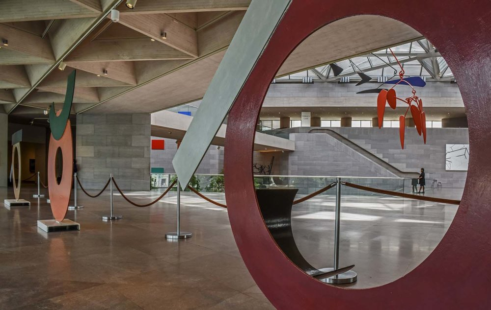 A trio of David Smith sculptures — Circle I, Circle III and Circle II — in the north window of the ground floor of the renovated museum. (Bill O'Leary/The Washington Post)