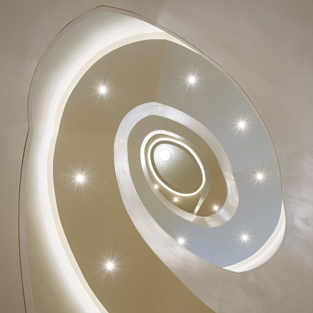 Looking up: spiral staircase at The George Washington University Museum | The Textile Museum. Completed in 2014. @gwmuseum . 📷: Bryan Becker Photography.  #architecture #washingtondc #gwmuseum #textilemuseum