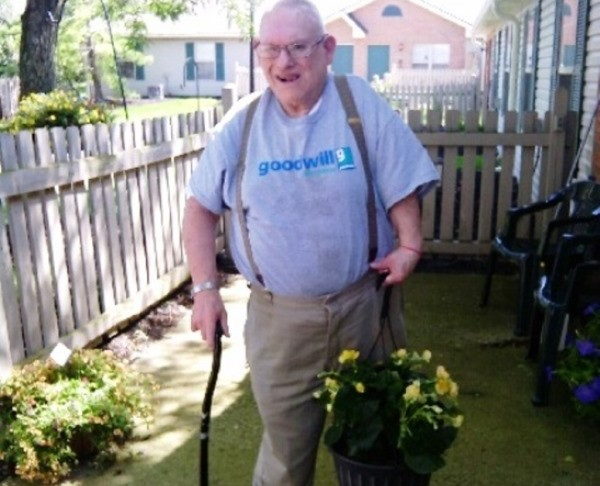 Parkmead resident Donald Frazier with begonias