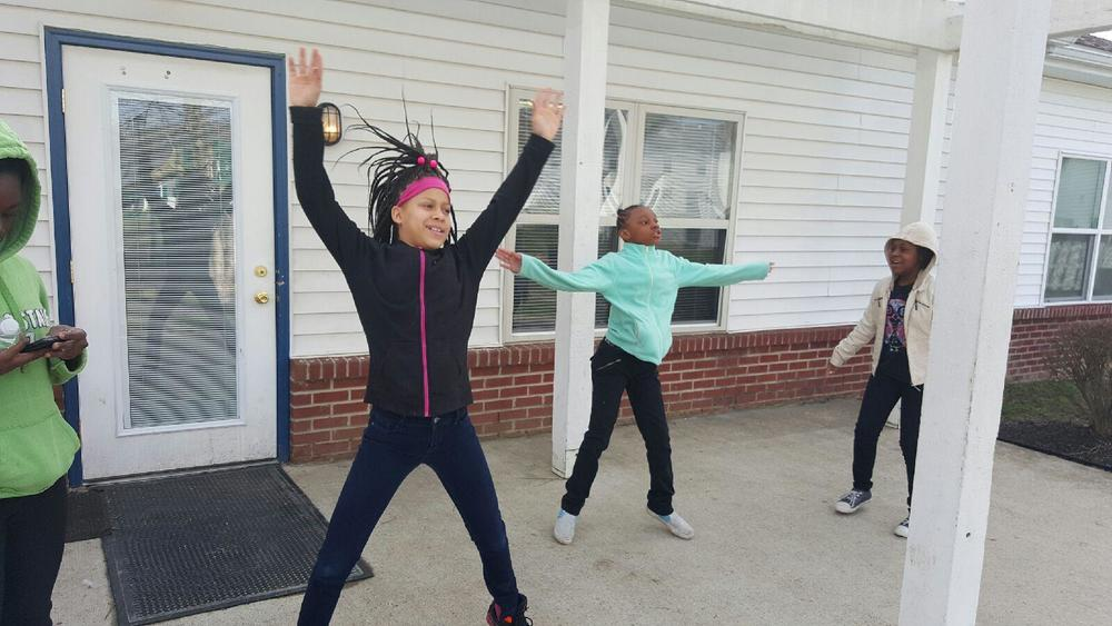 Marsh Run girls exercising on a Saturday outside Community Center