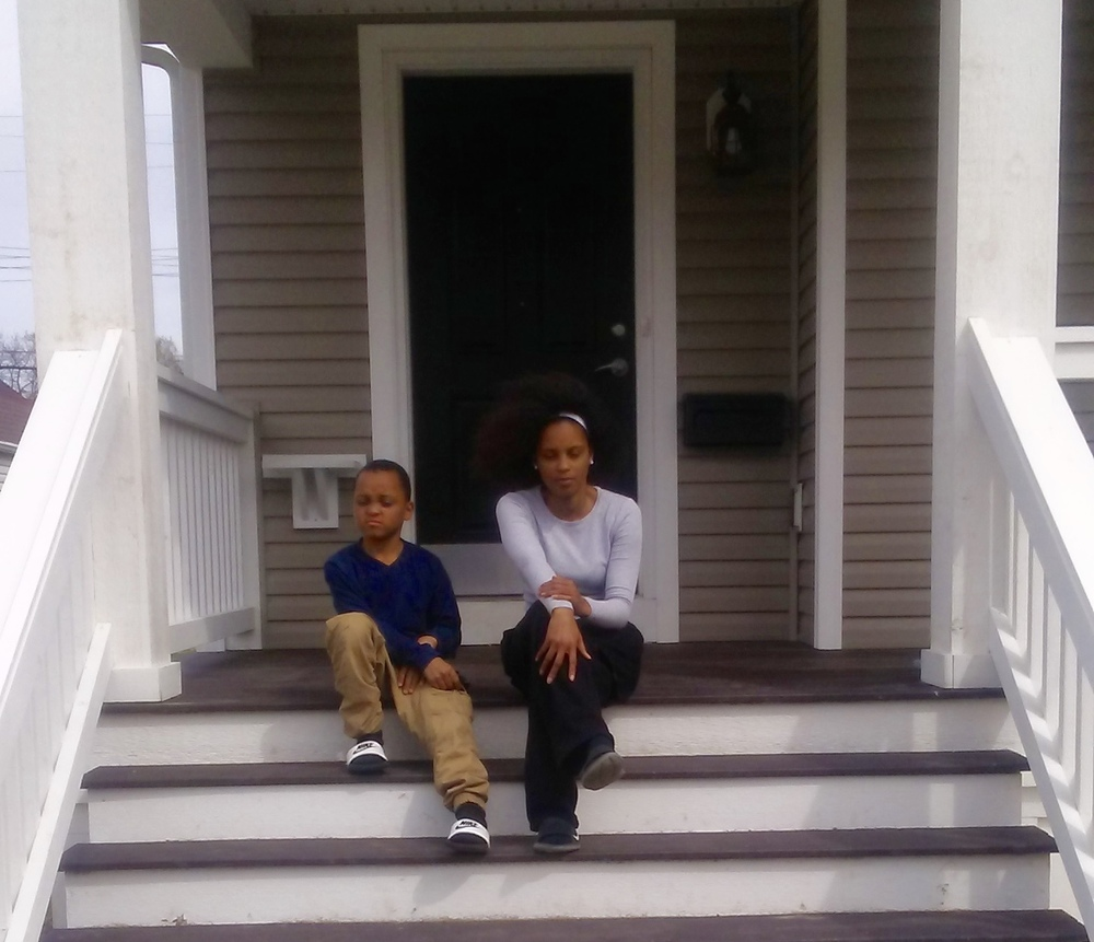 Qua-Shonda Cattling and son -- first to Hilltop Homes II