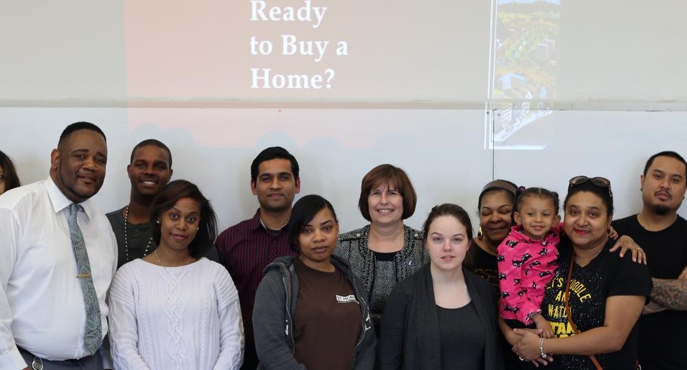 Karen Blickley, Nationwide Foundation VP, second row, center. Homeport Homebuyer Ed Counselor Kerrick Jackson, far left.