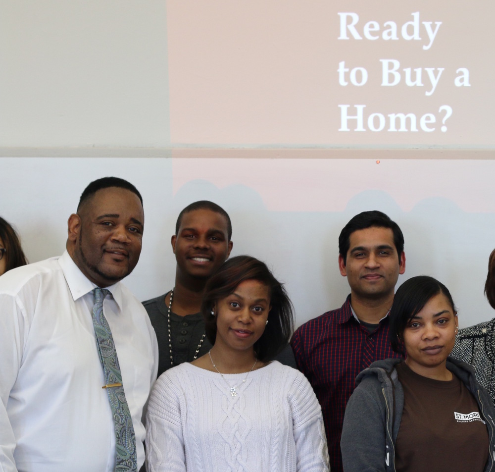 Homeport instructor Kerrick Jackson, left, and Homebuyer Education class