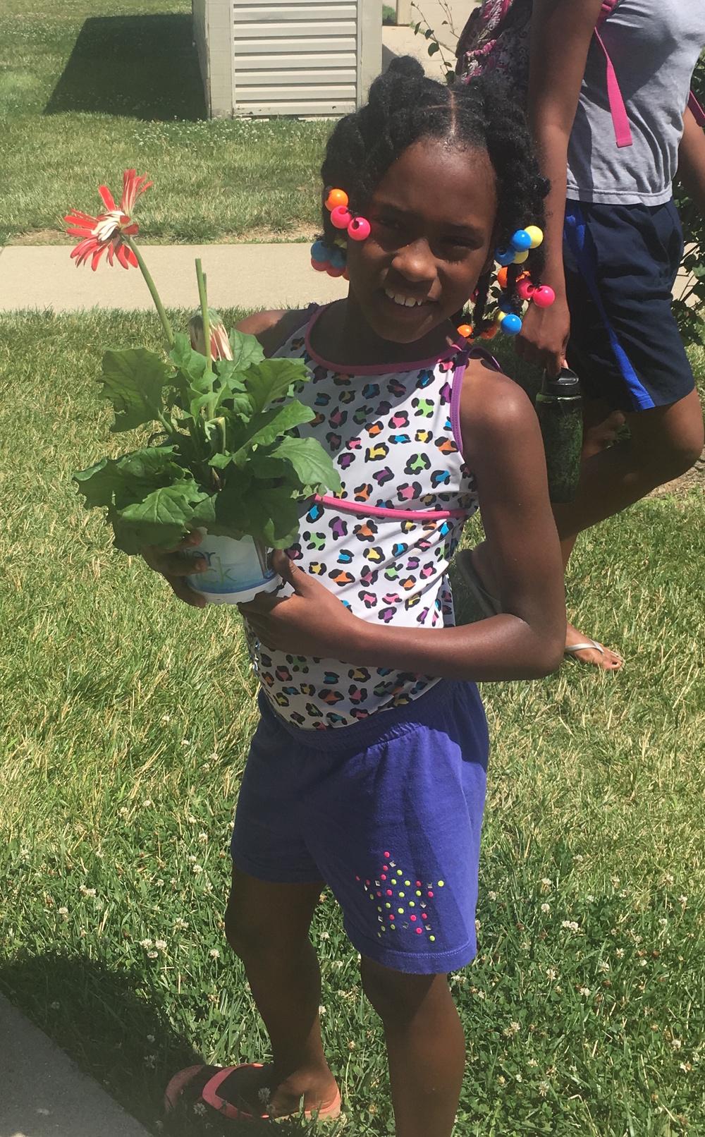 Pheasant Run's Aniyah Banks got a flower for her mom.