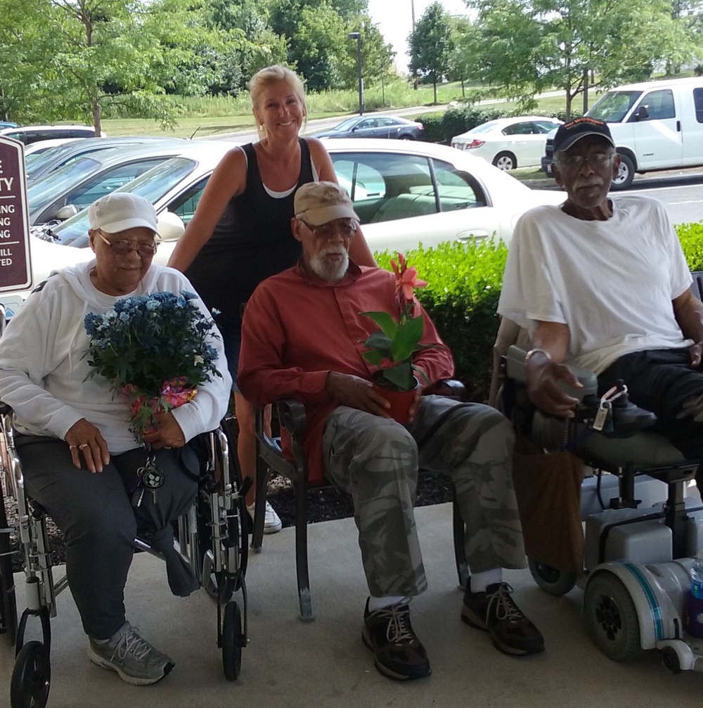 Senior residents at Fieldstone Court shared in the greenery from AmericanHort. Property Manager Michelle Roberts, in back, joined in the fun.