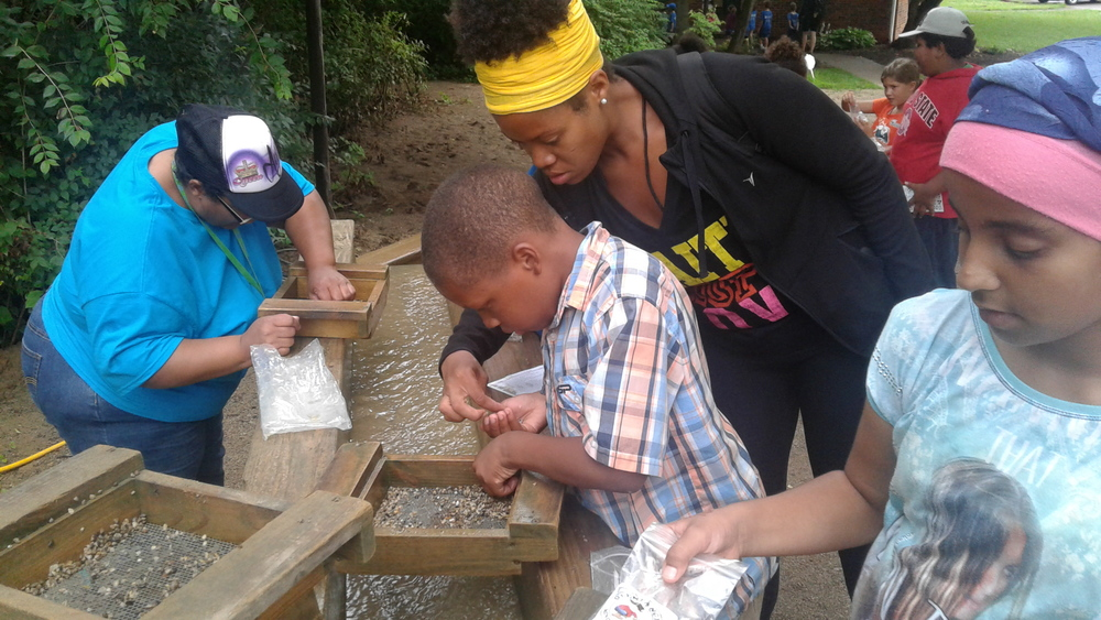 Elijah Woods, 9, center, of Trabue Crossing, goes mining at Olentangy Indian Caverns