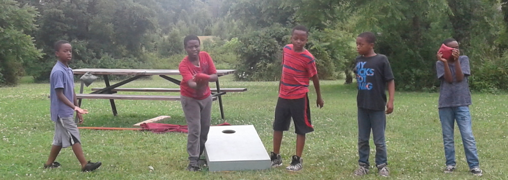 Homeport kids enjoy a game of Cornhole while visiting Olentangy Indian Caverns