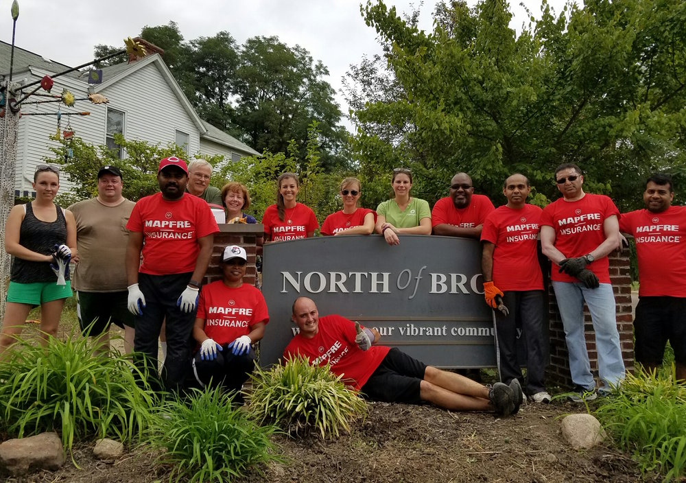 "North of Broad residents and MAPFRE Insurance teamed up in a volunteer effort to spruce up the ""NoBo"" community on the Near East Side."