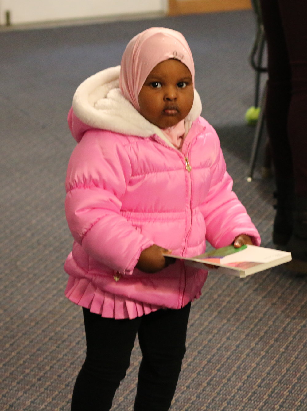 A young reader at Emerald Glen