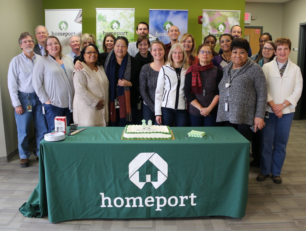 Homeport employees gather for 30th Anniversary cake cutting
