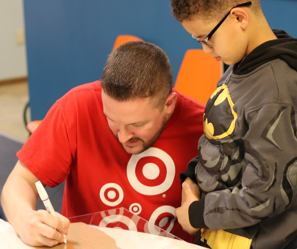 Target Store Team Leader Jeff Amos takes the lead on stenciling