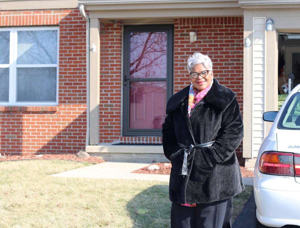 Linda Powell outside lease-option home she purchased the end of 2016.