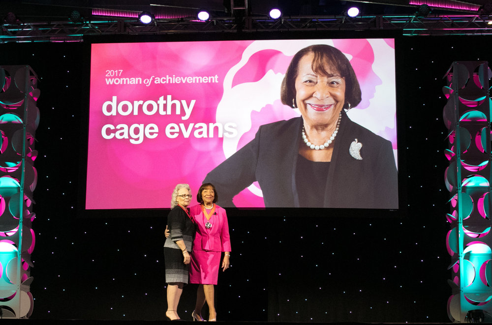 Dorothy Cage Evans on stage with previous YWCA Women of Achievement honoree Kathy Espy.