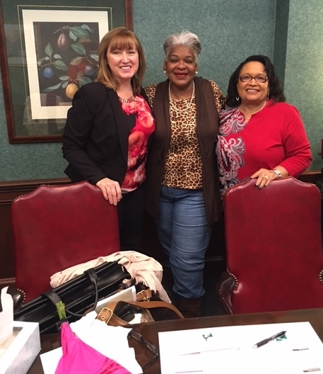 Framingham Village lease-option resident Linda Powell, center, at her home ownership closing flanked by Gail Blizzard, left, of Park National Bank, the lender, and Homeport's Brenda Moncrief, right.