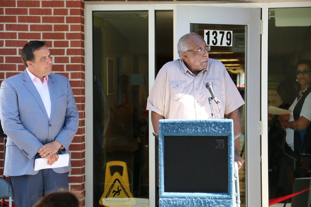 Columbus Mayor Andrew J. Ginther looks on as resident James Rogers expresses thanks for renovations that included an elevator at a 3-story Homeport senior apartment building on North High Street. The ribbon cutting ceremony was a celebration of improvements of three sites comprising Victorian Heritage.