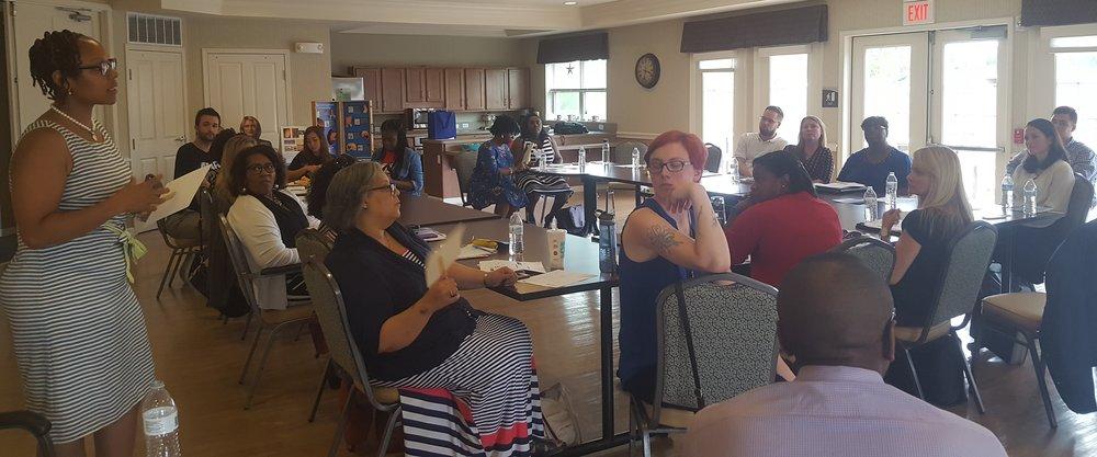 Columbus Public Health's Smoke Free Initiatives Program Manager Amber C. Jones, left, addresses Tobacco-Free Collaborative.