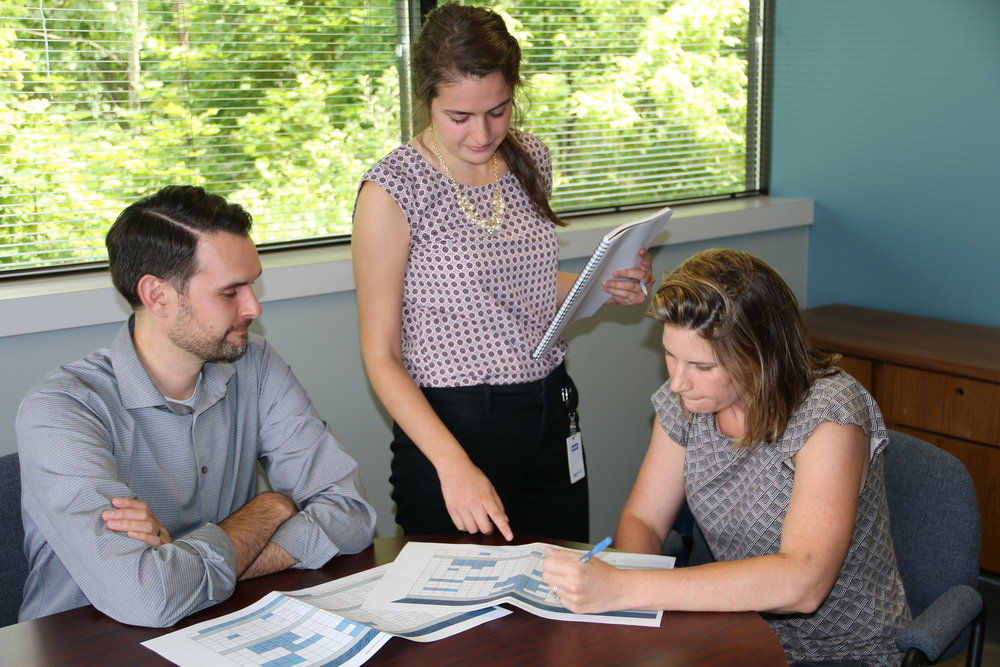Homeport's Alex Romstedt, left, and Morgen Wade, right, review Gifts of Kindness outcomes with Columbus Foundation Fellow Caroline Corona.