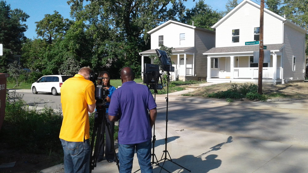 Leah Evans interviewed on Sampson Avenue by WOSU-TV across from a home being built by Homeport.