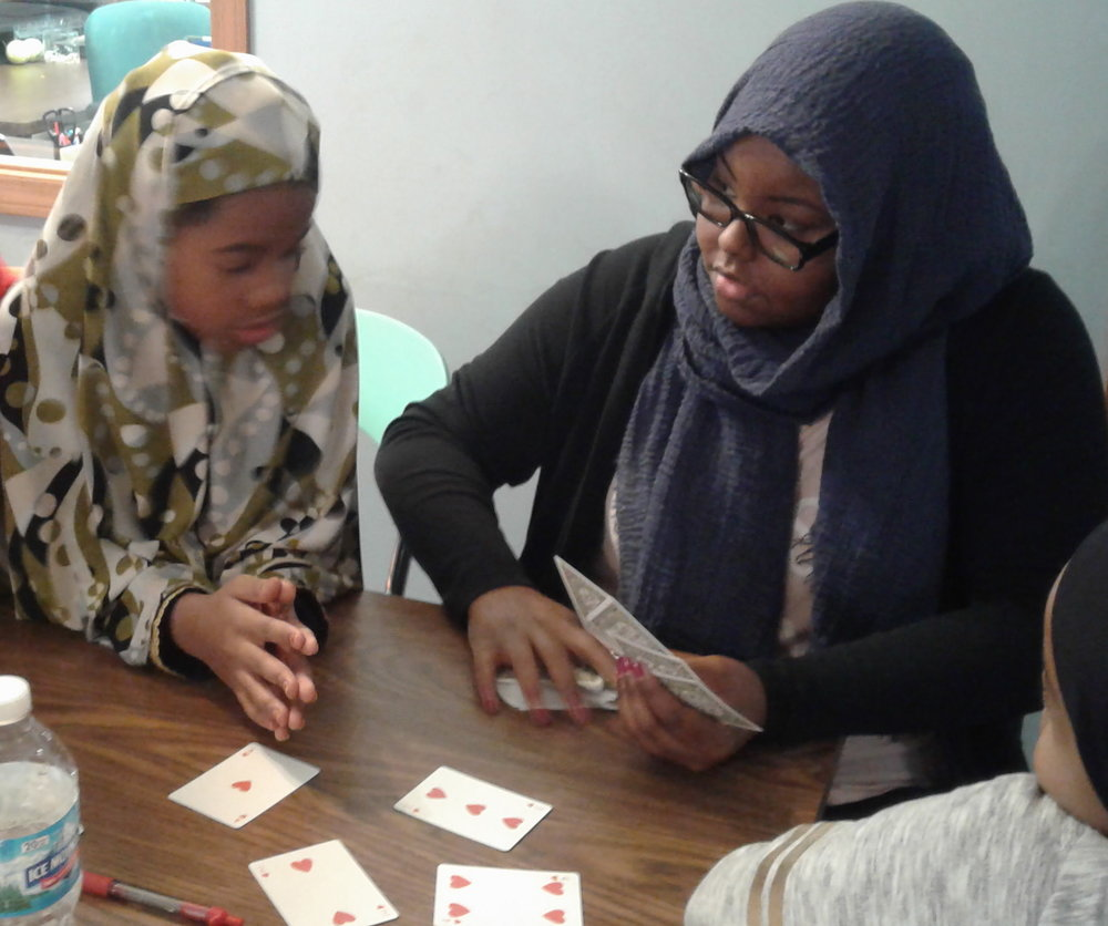 After school cards at Emerald Glen with ETSS Site Coordinator Saynab Yusuf, right.