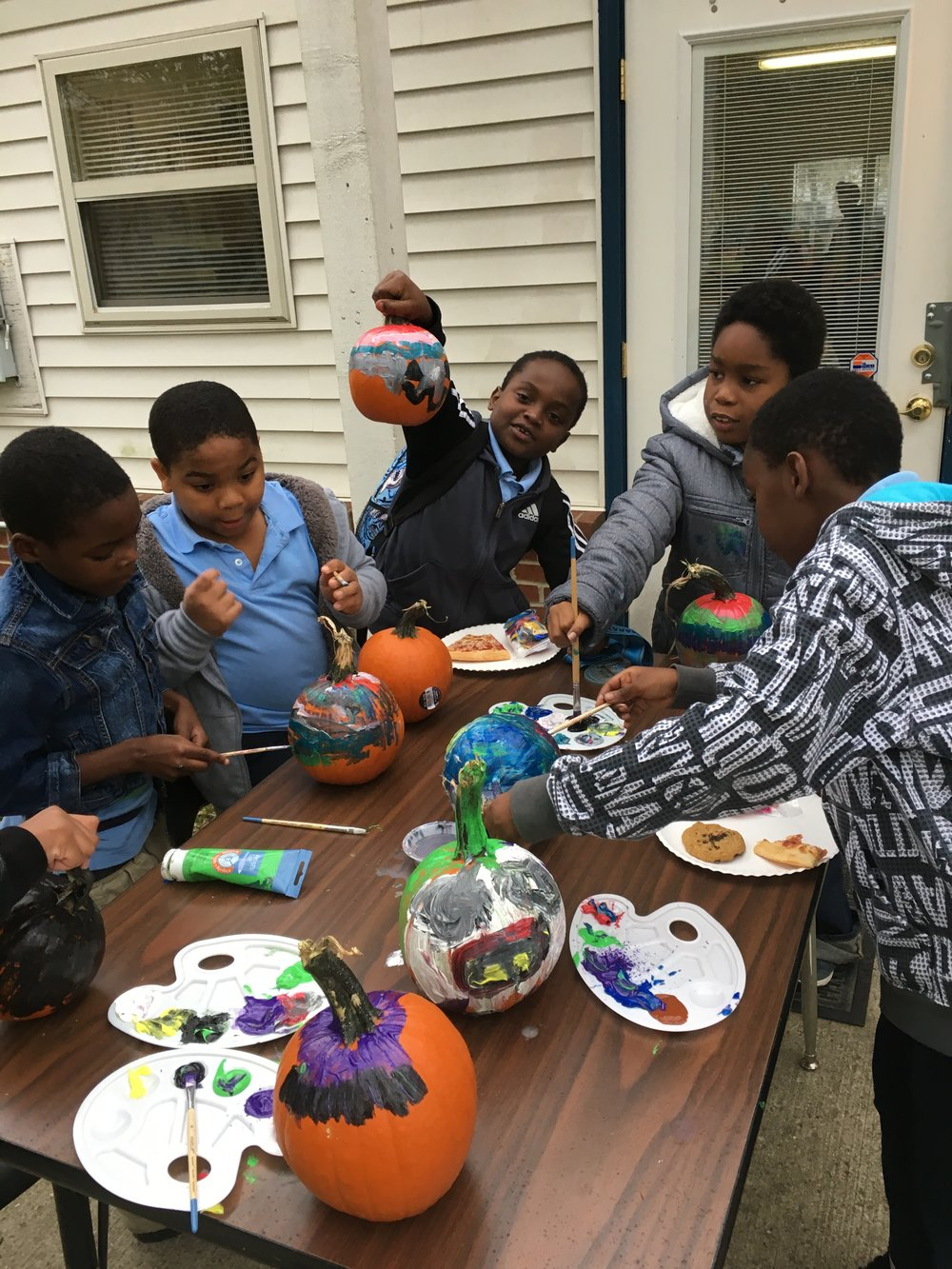 Pumpkin painting at Marsh Run community center back porch.