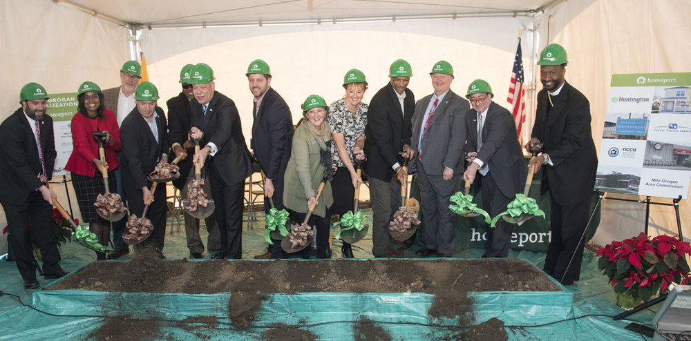 Chris Hune, Homeport Board chair, center, leads participants in ground-breaking ceremony at Milo-Grogan.