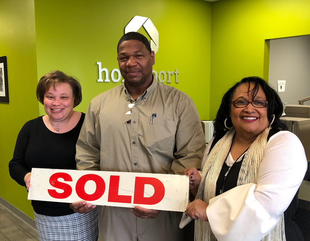 Barry celebrated purchasing his Greater Linden lease-option home this past week. To his right is Homeport's Brenda Moncrief,   Lease Option Program Manager. To his left is real estate agent Melle Eldridge of King Thompson.