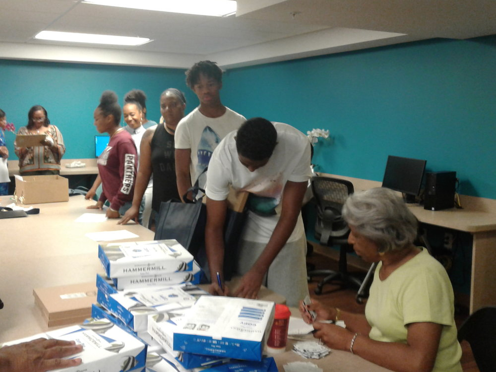 Helping Hands Board member Alice Porter assisting college-bound students.