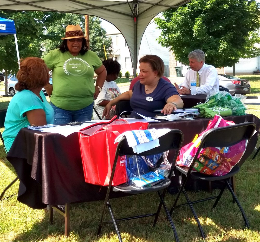 Homeport Lease Option Manager Brenda Moncrief, center, standing, explains how to purchase a home. On right is Realtor Melle Eldridge of Coldwell Banker/King Thompson. At next table is Huntington Bank mortgage originator Mike Smith.