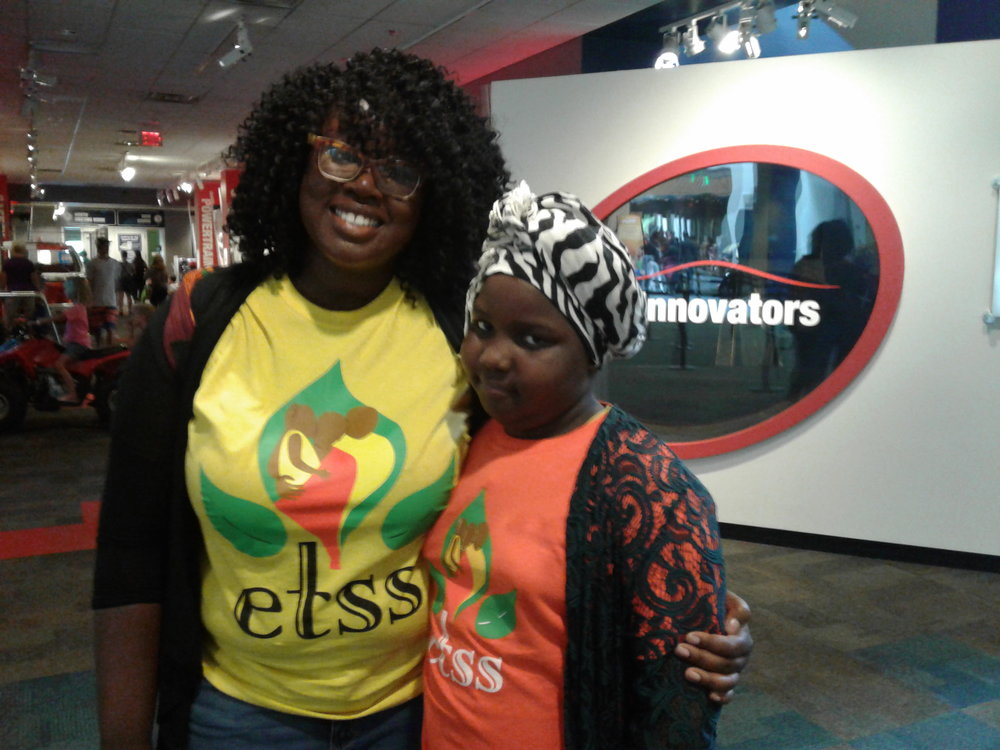 ETSS Lead Youth Program Coordinator Claudia Agyemang, left, at COSI, with Bending Brook resident   Hawa Hussien.