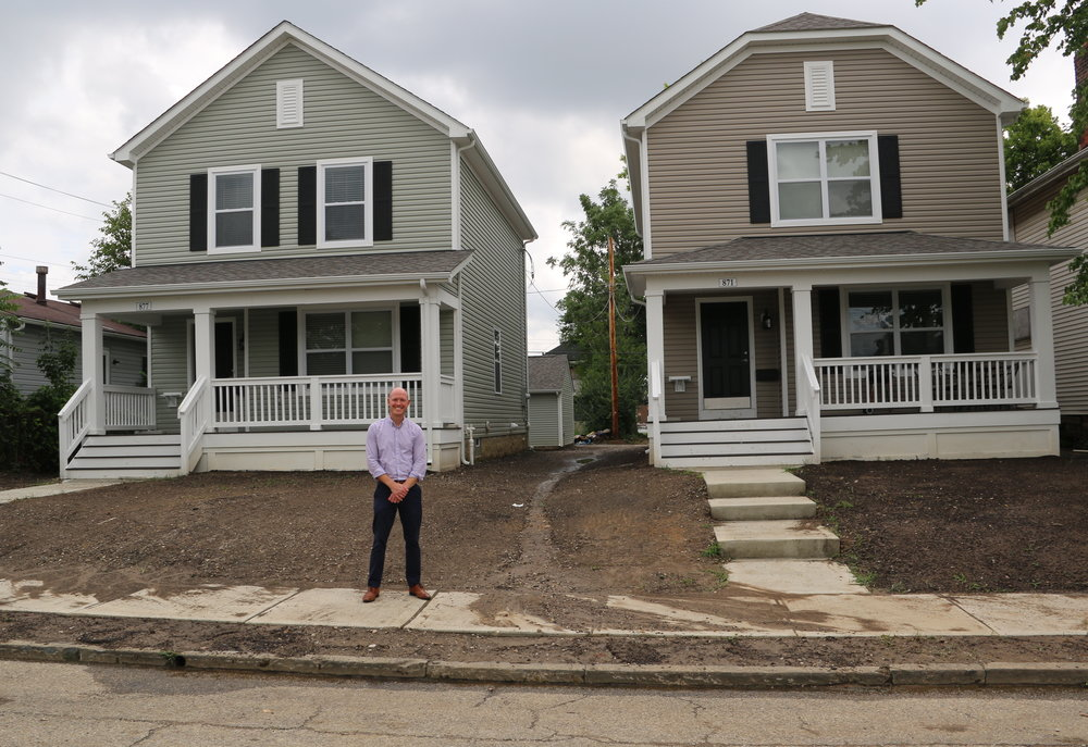 With support of Fifth Third Bank, Homeport recently built 33 homes single family homes as part of a revitalization initiative for the Milo-Grogan community of Columbus. Homeport Project Manager Justin Metzler stands in front of the last two homes constructed.