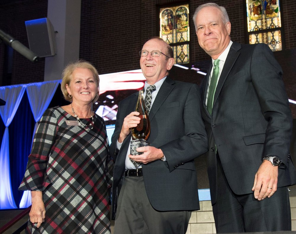 Homeport Board Chair Chris Hune, Voice & Vision honoree Rev. John Edgar, Homeport President & CEO Bruce Luecke