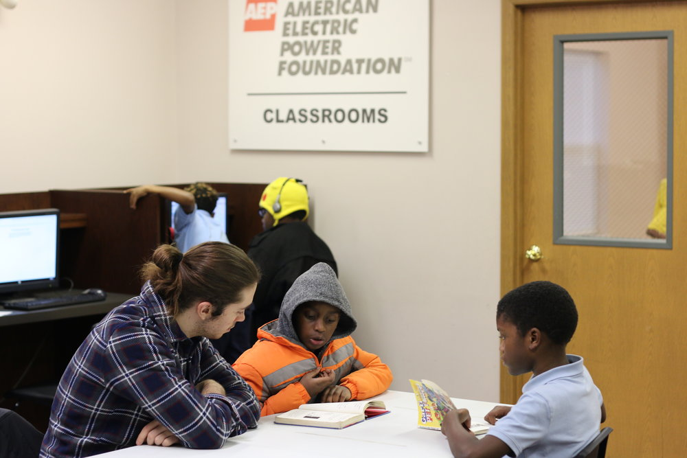 Studying space was added to the Marsh Run community center thanks to a donation from the American Electric Power Foundation. In photo above, Capital University student Jim Nagle, left, provides after school tutoring while others read or access books and computers.