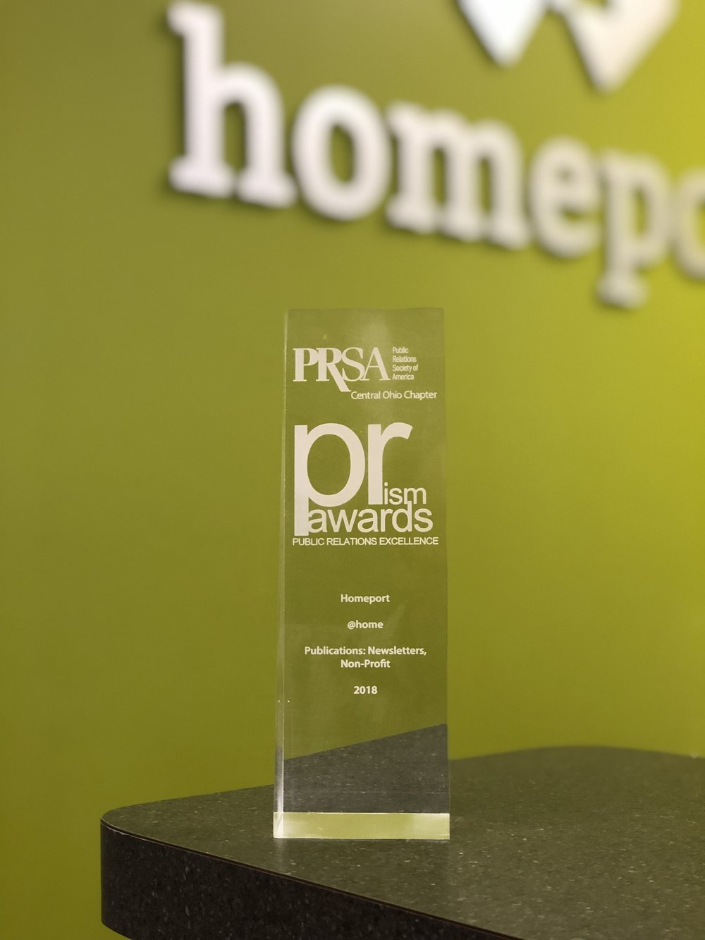 "Homeport received the 2018 Public Relations Society of America (PRSA) Central Ohio Chapter's ""PRism"" award for the top non-profit newsletter."