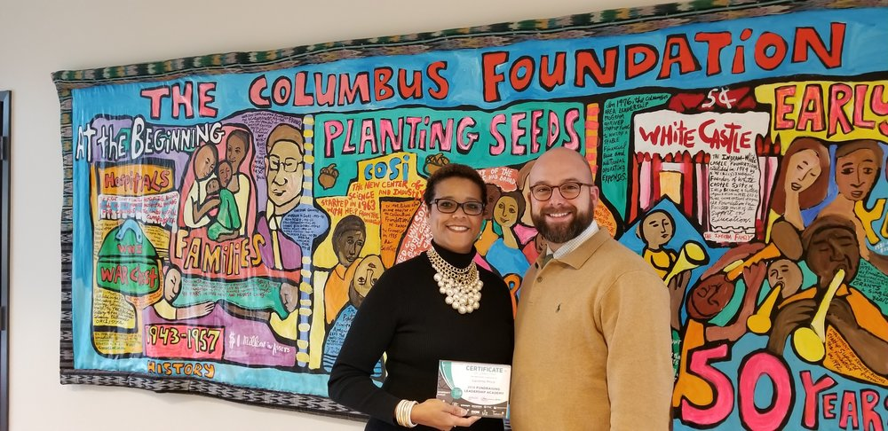 Homeport's Laverne Price holds certificate for graduating fundraising academy. Joining her in photo is Columbus Foundation's Dan Sharpe.