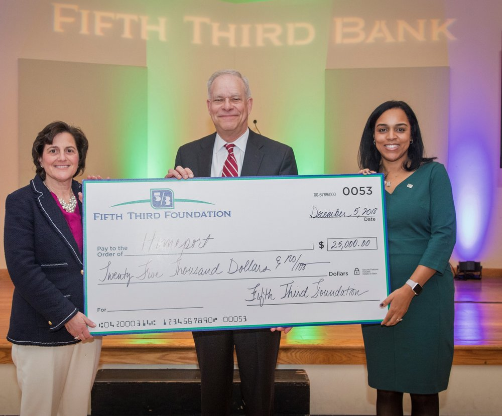 Fifth Third Bank Central Ohio President Francie Henry, left, Homeport President & CEO Bruce Luecke, and Fifth Third Bank Vice President Melissa Blount-Garner.