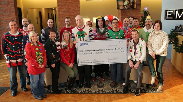 Homeport President & CEO Bruce Luecke and Homeport Senior Director of Resource Development Laverne Price accepted check from EMH&T. On far right is EMH&T President Sandy Doyle Ahern.
