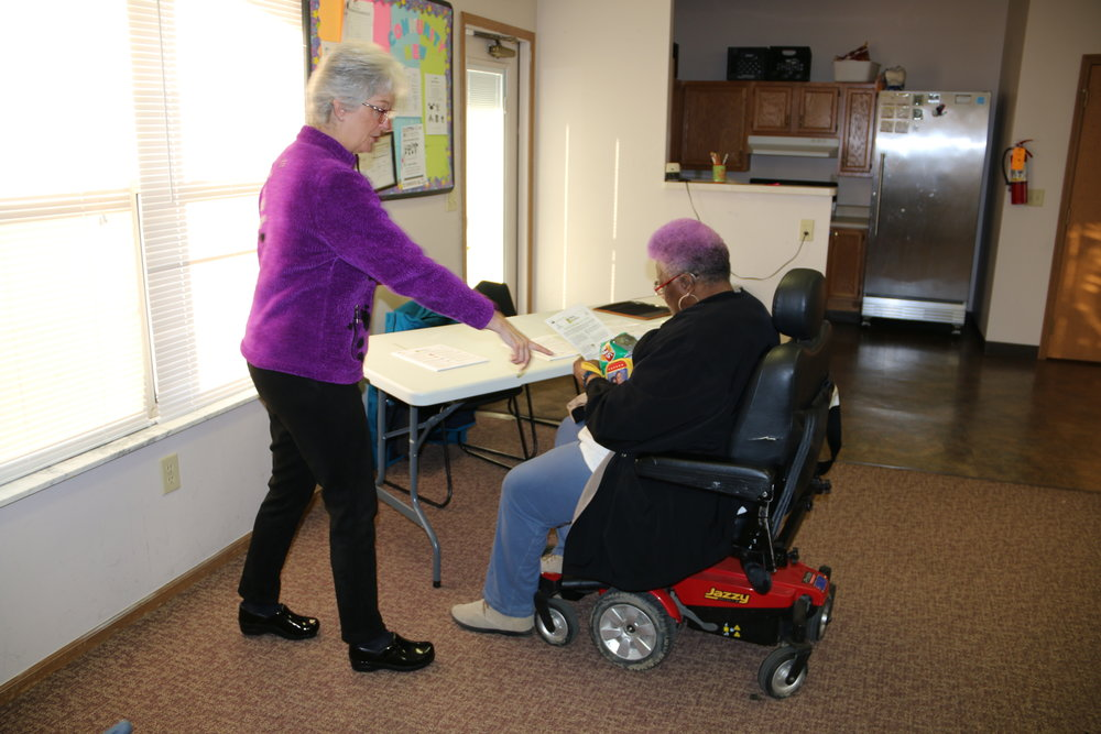 Central Ohio Diabetes Association Director Cathy Paessum, left, speaks with Marsh Run resident.