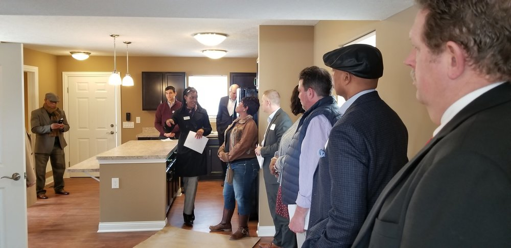 Homeport Sales Manager Angela Cradle explains the amenities of a new home in American Addition.