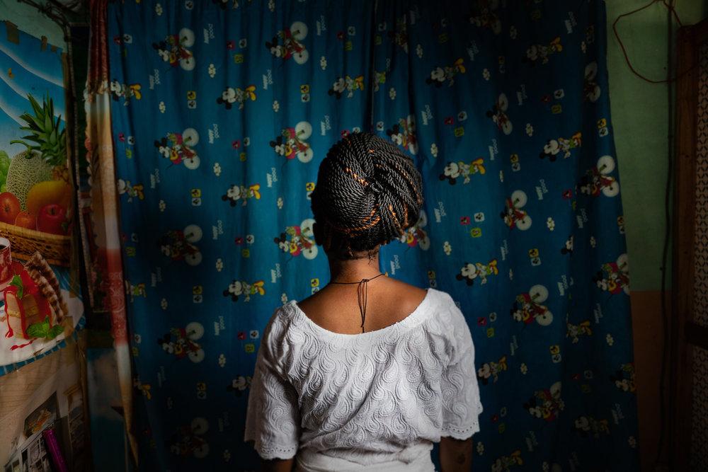 Benin_2000_Woman athe studio back.jpg